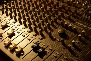 Vintage mixing board in low light.